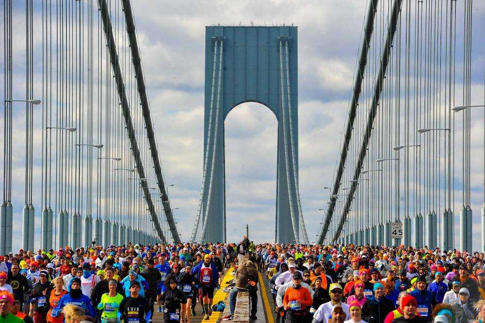 NEW YORK; NY - NOVEMBER 02:  Runners cross the Verrazano-Narrows Bridge at the start of the TCS New York City Marathon on November 2; 2014 in the Brooklyn borough of New York City.  (Photo by Alex Goodlett/Getty Images)
