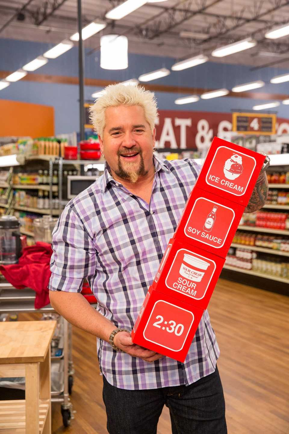 Host Guy Fieri with the dice for Game 1, Let It Roll,  as seen on Food Network's Guy's Grocery Games, Season 5.