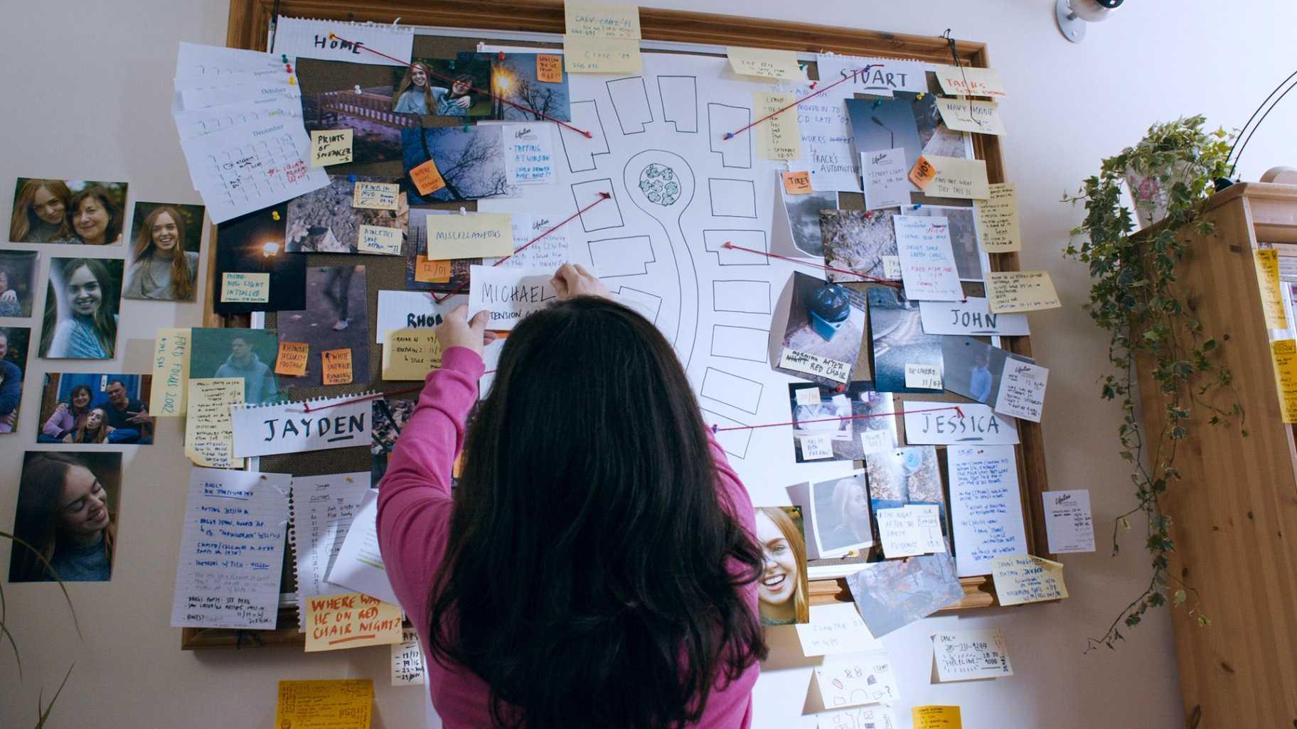 Toni sticks a card onto the board.