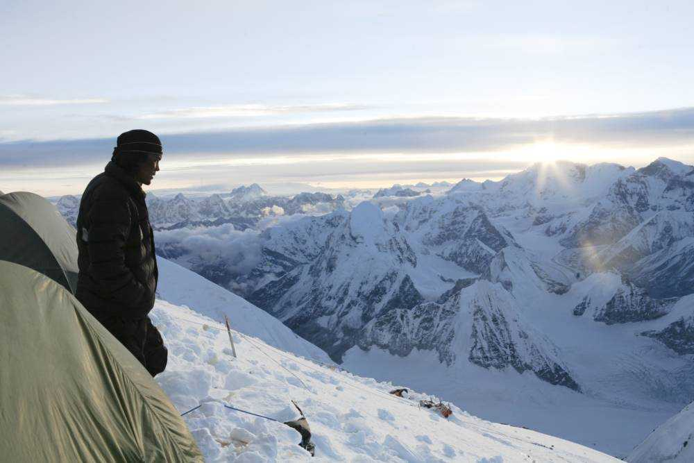 A sherpa reflecting on Mount Everest.