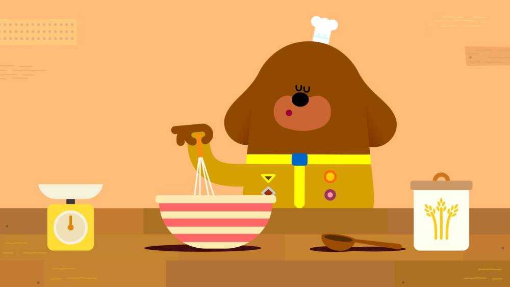 Duggee is happily whisking away