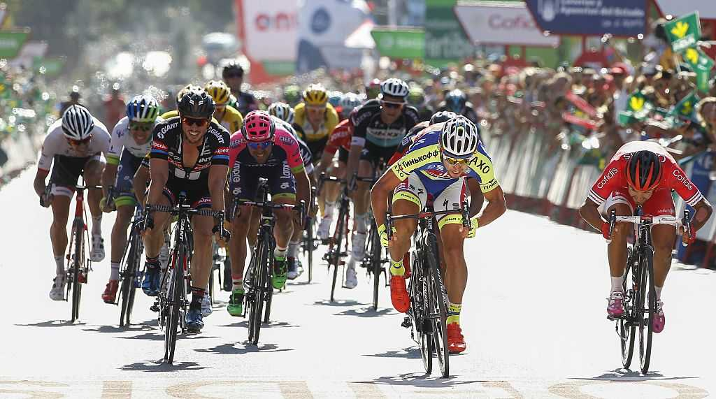 Tinkoff-Saxo Slovakian cyclist Peter Sagan (2ndR) crosses the finish line to win during the third stage of the 2015 Vuelta Espana cycling tour, a 158.4 km stage between Mijas and Malaga, on August 24, 2015.  AFP PHOTO/ JOSE JORDAN        (Photo credit should read JOSE JORDAN/AFP/Getty Images)
