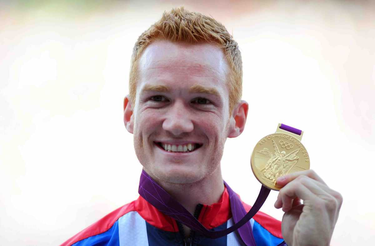 LONDON, ENGLAND - AUGUST 05:  Gold medalist Greg Rutherford of Great Britain pose on the podium for Men's Long Jump on Day 9 of the London 2012 Olympic Games at the Olympic Stadium on August 5, 2012 in London, England.  (Photo by Mike Hewitt/Getty Images)