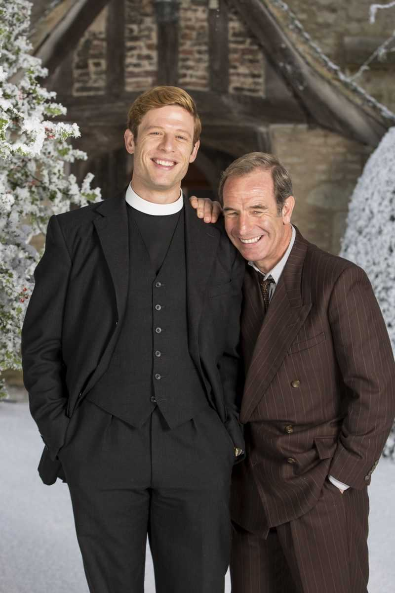 KUDOS FOR ITV  GRANTCHESTER CHRISTMAS SPECIAL  Pictured :JAMES NORTON as Sidney Chambers and ROBSON GREEN as Geordie Keating.  This photograph is (C) ITV Plc and can only be reproduced for editorial purposes directly in connection with the programme or event mentioned above. Once made available by ITV plc Picture Desk, this photograph can be reproduced once only up until the transmission [TX] date and no reproduction fee will be charged. Any subsequent usage may incur a fee. This photograph must not be manipulated [excluding basic cropping] in a manner which alters the visual appearance of the person photographed deemed detrimental or inappropriate by ITV plc Picture Desk.  This photograph must not be syndicated to any other company, publication or website, or permanently archived, without the express written permission of ITV Plc Picture Desk. Full Terms and conditions are available on the website www.itvpictures.com  For further information please contact: Patrick.smith@itv.com 0207 1573044
