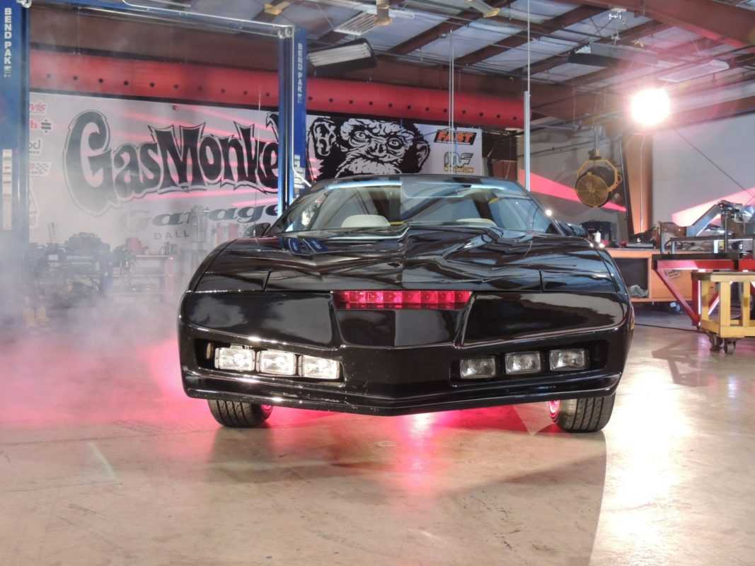 The restored 1985 Pontiac Trans Am KITT Car glows above an electrifying red light.