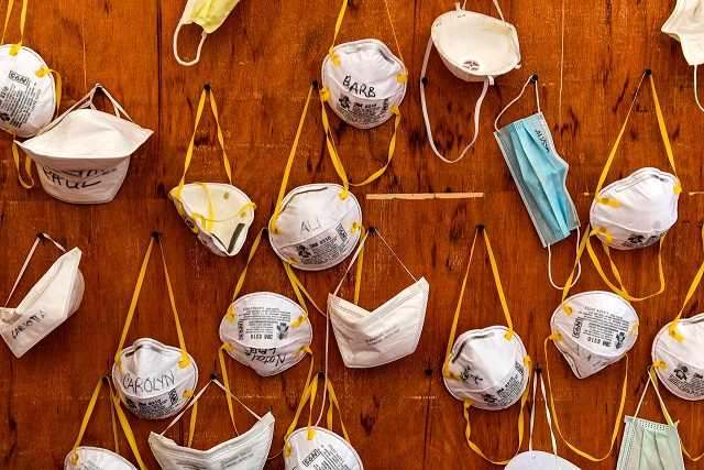 TOPSHOT - Protective masks bearing the names of medical staffers and nurses are pictured pinned to a wall on April 2, 2020 at the operative field hospital for coronavirus patients, financed by US evangelical Christian disaster relief NGO Samaritans Purse, outside the Cremona hospital, Lombardy. - Fully operational, the structure consist of 15 tents, 60 beds, 8 of which in intensive care. (Photo by MIGUEL MEDINA / AFP) (Photo by MIGUEL MEDINA/AFP via Getty Images)